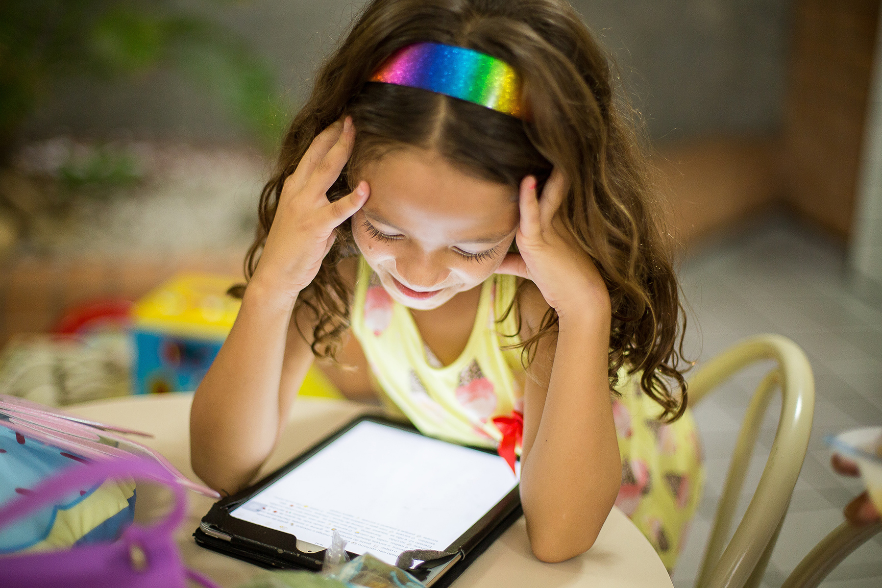 Girl smiles at tablet